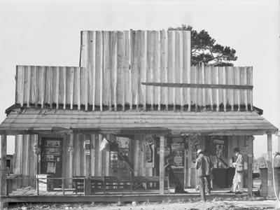Store with a false front in the vicinity of Selma, Alabama, 1936 by Walker Evans