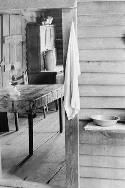 Washstand in the dog run and kitchen of sharecropper a cabin in Hale County, Alabama, c.1936 by Walker Evans