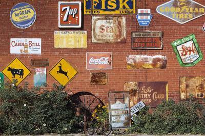 https://imgc.allpostersimages.com/img/posters/wall-of-advertising-signs-erick-oklahoma-usa_u-L-PN6VMJ0.jpg?p=0