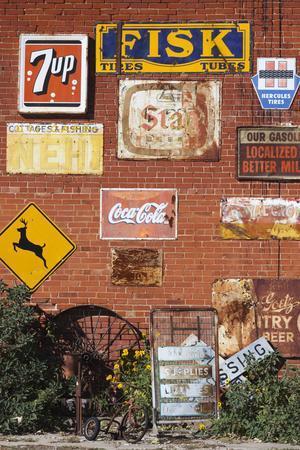 https://imgc.allpostersimages.com/img/posters/wall-of-advertising-signs-erick-oklahoma-usa_u-L-PN6VMY0.jpg?artPerspective=n