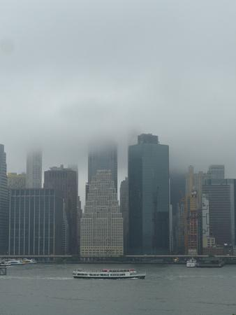 https://imgc.allpostersimages.com/img/posters/wall-street-office-towers-with-fog-and-east-river-boat-traffic_u-L-Q1EYEJW0.jpg?artPerspective=n