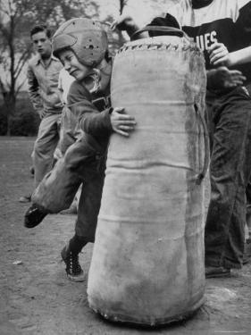 7 Year Old Tackling Dummy During Practice by Wallace Kirkland