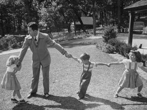Father Playing in Yard with His Children by Wallace Kirkland