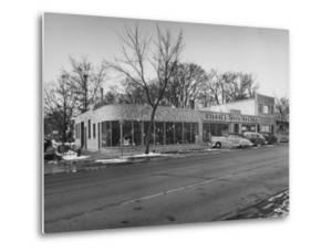Outside of George Higgins Pontiac Dealership by Wallace Kirkland