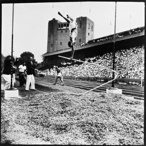 Pole Vaulter Harry Cooper's Pole Snapping During Olympic Trials by Wallace Kirkland