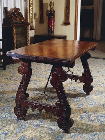 https://imgc.allpostersimages.com/img/posters/walnut-table-with-carved-legs-and-lyre-shaped-reinforcements-in-wrought-iron-spain_u-L-POPW3A0.jpg?p=0