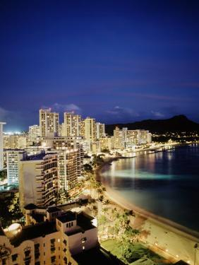 Aerial of Waikiki Beach at Night, HI by Walter Bibikow