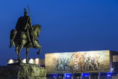 Albania, Tirana, Skanderbeg Square, Statue of Skanderbeg and National Historical Museum, Dusk by Walter Bibikow