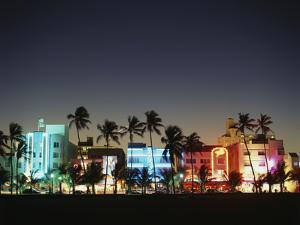 Art Deco Hotels at Dusk, Miami Beach, Florida, USA by Walter Bibikow