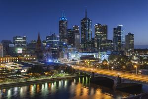 Australia, Victoria, Melbourne, Skyline with River and Bridge at Dusk by Walter Bibikow