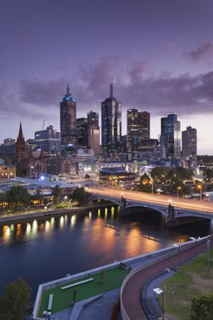 Australia, Victoria, Melbourne, Skyline with River and Bridge at Dusk