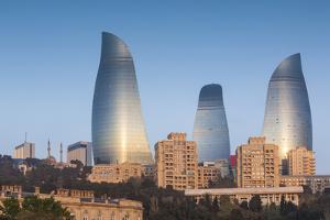 Azerbaijan, Baku. City skyline with Flame Towers from Baku Bay. by Walter Bibikow