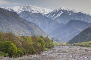 Azerbaijan, Kish. View of the snowcapped Caucasus Mountains. by Walter Bibikow