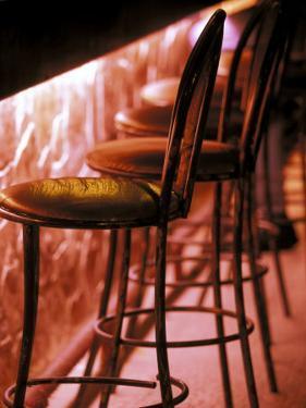 Barstools in pink light, Playa del Carmen, Quintana Roo, Mexico by Walter Bibikow