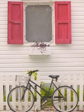Beach House and Bicycle, Loyalist Cays, Bahamas, Caribbean by Walter Bibikow