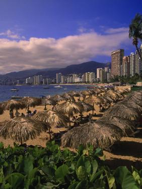 Beachfront on Playa Icacos, Acapulco, Mexico by Walter Bibikow