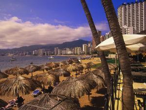 Beachfront Playa Icacos, Acapulco, Mexico by Walter Bibikow