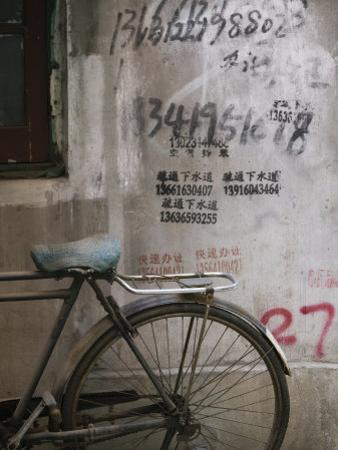 Bicycle and Graffitti, Taikang Road Arts Center, French Concession Area, Shanghai, China by Walter Bibikow