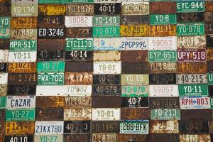 Building with License Plate Siding, Crested Butte, Colorado, USA by Walter Bibikow