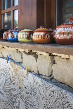 Bulgaria, Central Mountains, Arbanasi, Pottery and Embroidery by Walter Bibikow
