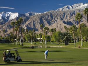 California, Palm Springs, Desert Princess Golf Course and Mountains, Winter, USA by Walter Bibikow