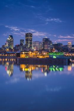Canada, Montreal, Skyline and Old Port Along St. Lawrence River, Dusk by Walter Bibikow