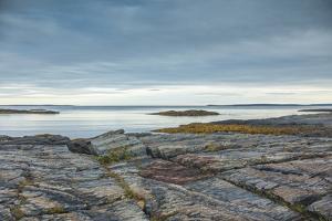 Canada, Nova Scotia, Blue Rocks. Coastal fishing village, rocky shoreline. by Walter Bibikow