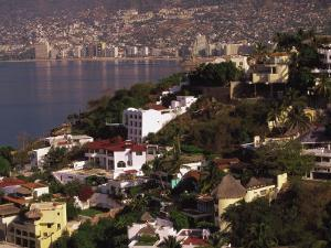 Cliffside Homes on Acapulco Bay, Mexico by Walter Bibikow