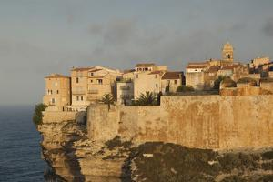 Cliffside Houses at Dawn, Bonifacio, Corsica, France by Walter Bibikow