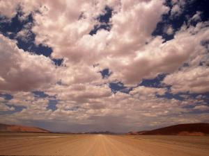 Clouds Over the Namib Desert, Namibia by Walter Bibikow