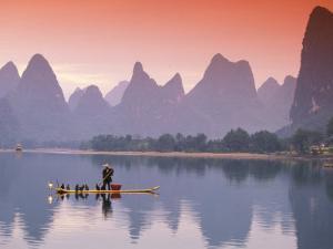 Cormorant Fisherman on Li River, China by Walter Bibikow