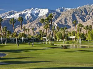 Desert Princess Golf Course and Mountains, Palm Springs, California, USA by Walter Bibikow