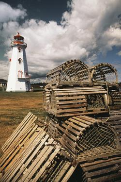 East Point Lighthouse and Lobster Traps, Prince Edward Island, Canada by Walter Bibikow