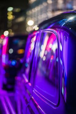 England, London, Soho, London Taxis Lit by Neon Lights by Walter Bibikow