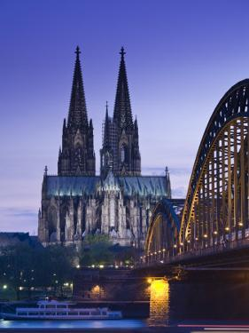 Evening, Cologne Cathedral and Hohenzollern Bridge, Cologne, Rhineland-Westphalia, Germany by Walter Bibikow