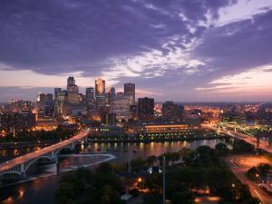 Evening Skyline Scene from St. Anthony Main, Minneapolis, Minnesota by Walter Bibikow