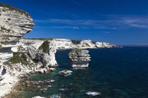 Falaises Cliffs Towards Capo Pertusato, Bonifacio, Corsica, France by Walter Bibikow