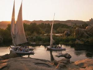 Feluccas on the Nile River by Walter Bibikow