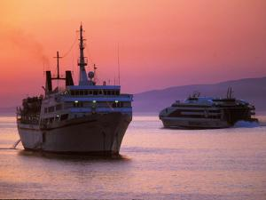 Ferry & Marine Traffic at Mykonos Harbor, Greece by Walter Bibikow