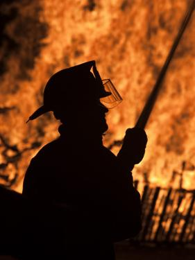Fourth of July Holiday Bonfire, Rockport, Massachusetts, USA by Walter Bibikow
