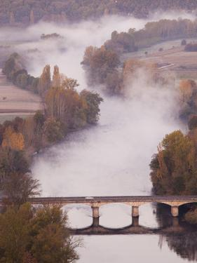 France, Aquitaine Region, Dordogne, Domme, Dordogne River Valley in Fog from the Belvedere De La Ba by Walter Bibikow