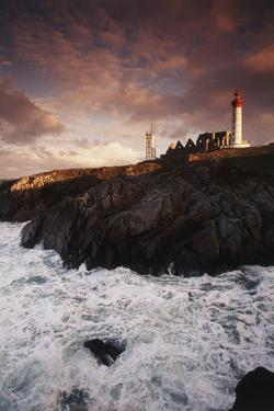 France, Brittany, Finistere, Saint-Mathieu. Lighthouse at Dawn by Walter Bibikow