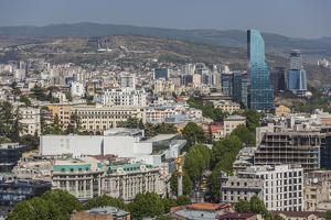 Georgia, Tbilisi. City skyline from Narikala Fortress. by Walter Bibikow