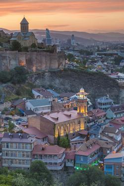 Georgia, Tbilisi. Old Town, Muslim Quarter and Narikala Fortress. by Walter Bibikow
