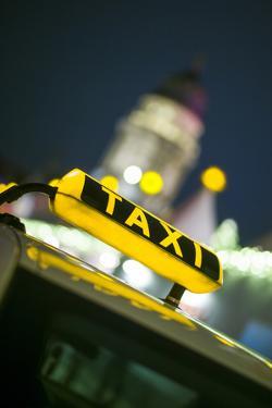 Germany, Berlin, Christmas Market, Taxi with Deutscher Dom, Dusk by Walter Bibikow