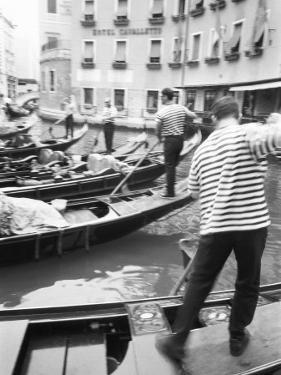 Gondoliers, Venice, Italy by Walter Bibikow