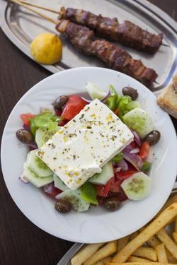 Greece, Peloponnese, Corinth, Greek Salad with Souvlaki and Fries by Walter Bibikow
