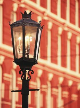 Illuminated Street Light, Galveston, Texas, USA by Walter Bibikow