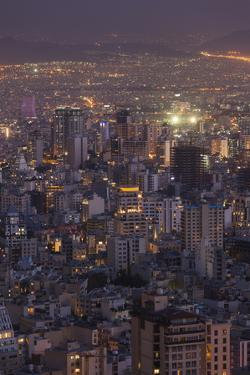 Iran, Tehran, Elevated City Skyline With Iran Park Towards The Milad Tower by Walter Bibikow