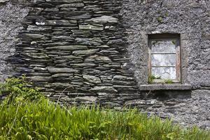Ireland, County Cork Ring of Beara, Garnish, traditional stone house by Walter Bibikow